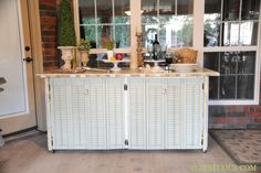 great idea for recycling and an outdoor buffet/sideboard