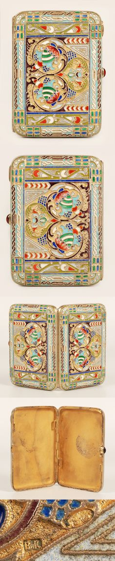 A Russian silver gilt and cloisonne enamel cigarette case, maker's mark Vik, Moscow, circa 1908-1917. Decorated with flowers within a frame of chain-work in multi-color chrome enamels, gilt interior and cabochon thumb piece.