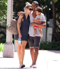 Doutzen Kroes and her husband DJ Sunnery James and her son Phyllon enjoyed a family stroll in Miami. Too cute!