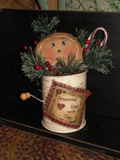 Primitive Gingerbread Face in Distressed Sifter Arrangement Gingerbread Crafts, Christmas Gingerbread Men, Gingerbread Decorations, Primitive Christmas, Rustic Christmas, Xmas Decorations, Vintage Christmas, Christmas Holidays, Christmas Ornaments