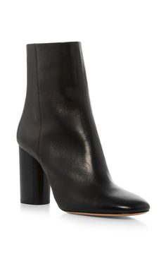 These **Isabel Marant** boots feature a 100% calf leather composition, back zipper with tassel, and stacked heel.