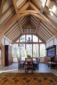 The dining room is often the hub of the home for entertaining and evening meals so why not make it extra special with an oak frame, vaulted ceilings floor-to-ceiling glazing allowing the light to flood through.  #diningroomideas #oakframe #vaultedceilings #oakbeams
