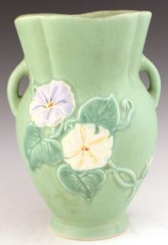 WELLER GREEN POTTERY VASE.  Weller Pottery was founded by Samuel Weller in Fultonham, Ohio, United States in 1872.