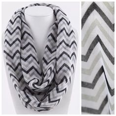 """B37 Chevron Black White Tan Infinity Scarf Black, white & tan chevron print infinity scarf.  Lightweight and perfect for year round wear.  100% viscose.   Please check my closet for many more items!!!      ‼️️PRICE FIRM UNLESS BUNDLED‼️  Length 32""""  Width 20"""" Boutique Accessories Scarves & Wraps"""