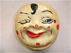 """Is it just me, or does this guy look like he's been hitting the bottle? """"Man in the Moon chalkware string dispenser"""""""
