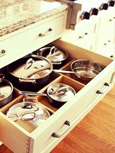 I really like this new trend of drawers for your pots and pans. Makes much more sense than putting them in a cupboard.