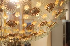 IKEA Sputnik Chandelier with flowers cut down, painted gold and small plastic bowls attached to each one.