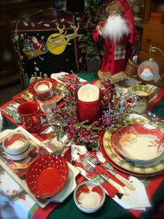 We've set a table with Vietri's classic Old St. Nick China, mixed with their Rosso Vecchio and Rosso Vecchio Dot.  Standing Guard is Vietri's Special OSN inspired St. Nick by Lynn Haney!  Notive Vietri's fun OSN table linens...