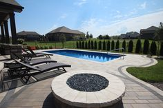 This is a Viking Lakeshore in the Azure Color. This is a Salt Water Pool that features a Coverstar Automatic Pool Cover. There is a pipe sticking up in the photos and that is actually for a future slide.  The paver surround is done with Belguard Pavers. This pool also features a Paver Lid system to hide the Automatic Pool Cover Box.