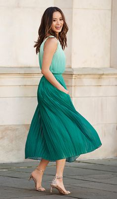 Our green pleated midi dress has a really pretty texture and flowy shape. Add a scarf, neutral belt and heels to play up the pattern. Or put a top over it and add a jean jacket for a completely different look | Banana Republic