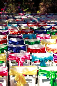 Wedding seat bows - This *could* get expensive if you have over 100 guests, but still - nice way to dress up a big bunch of rental chairs!  @ Terry Postma (for Becah's wedding)