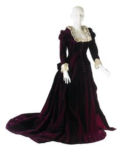 Dress, House of Worth: 1886, French, front-lacing bodice with Gothic Revival details, velvet, trimmed with lace.