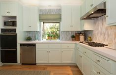 Beach Style Kitchen by Charmean Neithart Interiors, LLC.