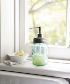 """Repurpose the classic Mason jar as a soap or lotion dispenser in your bathroom. Step 1: First, measure and mark the center of the jar's lid. Step 2: Using a 1/2"""" high-speed steel drill bit (about $10; local hardware store), drill a hole to fit the width of a soap dispenser pump. We used pumps from old lotion bottles.      Step 3: Fill the jar with liquid soap, screw the lid back on, and insert the pump. You may need to trim the bottom of the pump to fit your jar."""