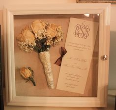 bouquet, husbands boutonniere and program from wedding. Framed in a Shadow box