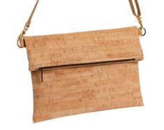 This cork wristlet is the perfect accessory! Handmade from eco-friendly cork. Cork fabric Organic (and fair trade!) cotton lining Zipper closure Removable wristlet strap Gold hardware Small: 7.5W x 5H Large: 10W x 5.5H   WHAT IS CORK FABRIC? Cork shavings removed from the bark of the cork oak tree are transformed into ultra thin sheets to produce cork fabric. Cork is a natural and sustainable material harvested from cork oak trees every nine years without harming or killing the trees. The… Cork Purse, Pouch Pattern, Cork Fabric, Fabric Sewing, Handmade Purses, Oak Tree, Fair Trade, Gold Hardware, Biodegradable Products
