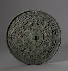 Mirror decorated with dragons, 11th–12th century. Goryeo dynasty (918–1392)…