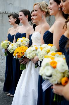 love the bridesmaid dresses and and bridal bouquet  Photo: Alea Moore Photography