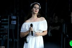 All eyes on her: The singer looked angelic in an off-the-shoulder white dress and matching...