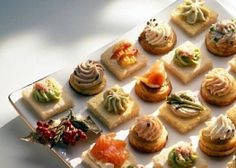 finger food mousses piped onto crackers and breads