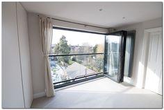 bifold glass doors and glas balustrade loft conversion NW london - Visoko potkrovlje House, Balcony Doors, Dormer Loft Conversion, Dormer Windows, Loft Door, Loft Room, Glass Bifold Doors, Loft Spaces, Loft Inspiration