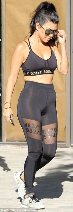 Gym bunny: The reality star also wore grey trainers and carried her mobile phone, complete with Kimoji case
