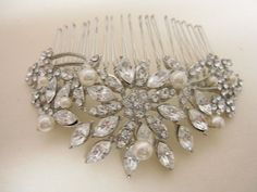 Hey, I found this really awesome Etsy listing at https://www.etsy.com/listing/187822808/vintage-inspired-pearls-bridal-hair-comb