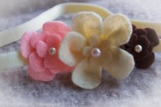 Pink, brown and cream coloured floral headband with a pearl centre and cream band on Etsy, $4.00 CAD