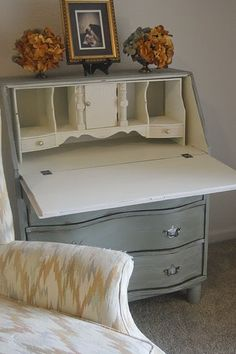 General Finishes Milk Paint in Basil, glazed her with snow white and distressed her along the edges of the drawers and frame. The hardware is original legs are new.