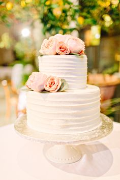 White two tier blush floral topped wedding cake: Photography: Kelly Dillon Photography - www.kellydillonphoto.com   Read More on SMP: http://www.stylemepretty.com/2016/07/11//