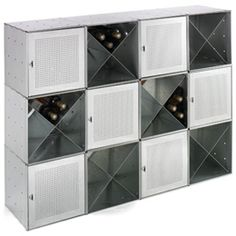 I feel like this is what I want to do with some of the shelves in my Ikea bookshelf but the X divider is $26.99! The Container Store > Galvanized QBO® Steel Cube Wine Bar