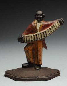 This cast iron doorstop is made by Spencer. Great depiction of black accordion player with superb form. Nice piece of black Americana.