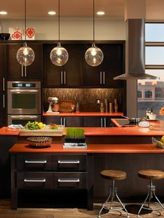 Nice splash of color in the kitchen  lighting motif fits perfectly! #DesignPinThurs