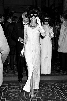 Gloria Guinness making her entrance at Capote's Black & White Ball 1966