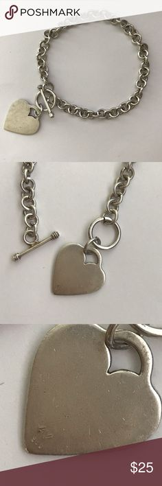"""Vintage Sterling Silver Heart Charm Bracelet Sterling silver heart charm bracelet Approx. 7.5"""" length Toggle clasp closure Hallmarked: AV, 925 ITEM HAS SIGNS OF WEAR. SCRATCHES AND TARNISH Jewelry Bracelets"""