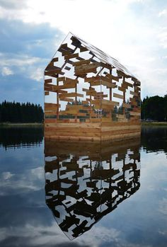 Walden Raft is a cabin offering seclusion in the middle of a French lake.This see-through floating hut designed by Elise Morin and Florent Albinet is modelled on the remote cabin built by American author Henry David Thoreau in the century (+ slideshow). Wood Architecture, Contemporary Architecture, Floating Architecture, Memorial Architecture, Computer Architecture, Enterprise Architecture, Glass Cabin, Glass House, Pavillion