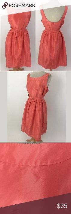 "J. Crew silk dress Waist: 35"" Bust: 42.5"" Shoulder to hem: 39.5"" 100% silk, lined in 100% acetate. It has a faint, minor mark below the neckline in front. Please see picture. The dress is a coral-peach color.  Item #1697 J. Crew Dresses"