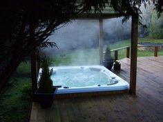 Amazing outdoor hot tub relaxing area! Imagine using a warm spa during the winter.