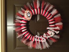 The UGA tulle wreath I made for the past couple of nights! Football fever has officially hit my house!! :) Go Dawgs!! #uga #georgia