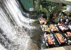 A restaurant where you eat barefoot (or in your mermaid fin) in water from a waterfall. This is the perfect restaurant for a mermaid. - Villa Escudero is located in Quezon Province, Philippines.