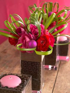Merry and Bright Table Arrangement.        A small glass vase rests in a larger vase, and the space between is filled with coffee beans; flowers or candles are placed in the center. This is a fun arrangement for a long table.