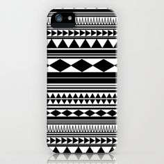 """I'm a huge fan of black and white contrast because I believe it gives most designs a more elegant look to them. Though this design has that """"tribal"""" aspect to it the black and white gives it a more modern feel. I also like the repetition of the hard shapes (diamonds, triangles, straight lines) throughout the design. It gives structure to an otherwise hectic design."""