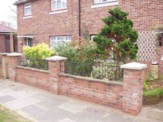 Here is a Garden wall with iron railing inserts between the piers and has been constructed using facing bricks in stretcher bond Front Fence, Fence Gate, Wall Railing, Railings, Walled Garden, Brickwork, House Renovations, Patio, Landscape
