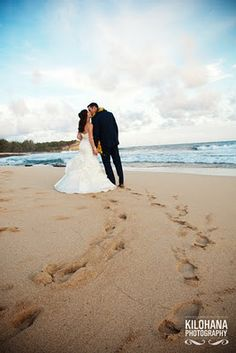 I seriously want to a Trash the Dress session in Kauai for my Honeymoon...I've been on that beach :)