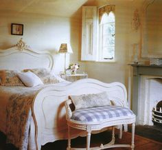 Fabrics in soft blue greys create a fresh feel in this french style guest bedroom