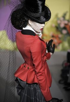 One of John Galliano for his Dior spring couture collection's beautiful riders in a peplumed jacket, bustled skirt and top hat. Tally ho!
