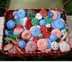 A whole tin of colorful housedress buttons.  Do you collect these?