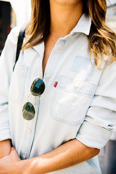 Catching shade. Simple weekend style  - pair round frame sunglasses (like these Ray Ban shades) with a chambray button-down shirt and dark denim. #LadiesInLevis