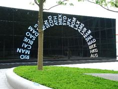 Structurally Silicone Bonded Glazed Wall, Black Obscured Laminated Glass, no visable fixngs.