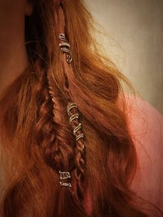 These are wire wrapped spiral hair cuffs that comfortably wrap around your hair. In the photos you can see both silver tone and gold tone